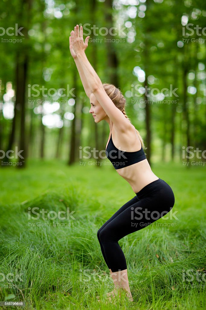 Beautiful yoga session in woods stock photo