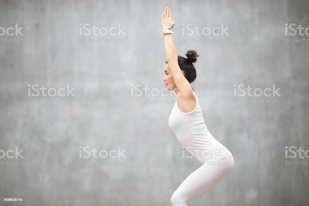 Beautiful Yoga: Utkatasana pose stock photo