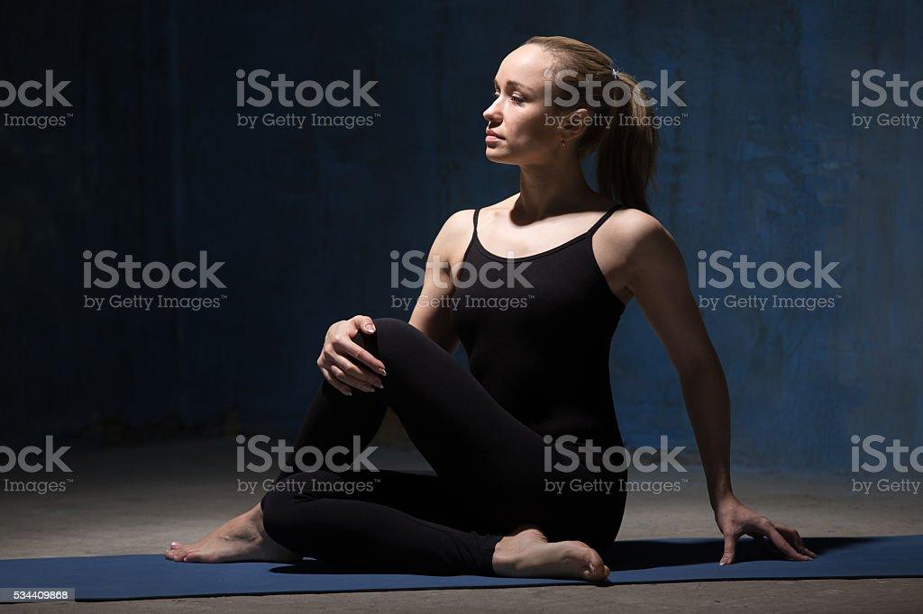 Beautiful Yoga Woman Doing Ardha Matsyendrasana Pose stock photo