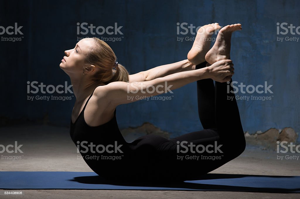 Beautiful Yoga Woman Doing Bow Pose stock photo