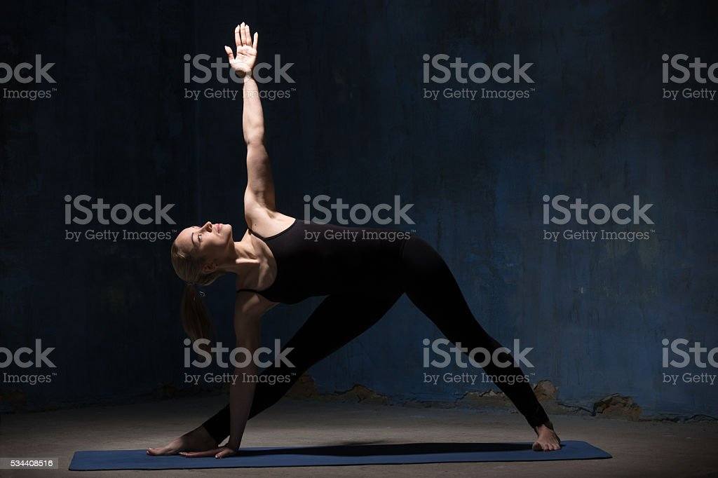 Beautiful Yoga Woman Doing Extended Triangle Pose stock photo