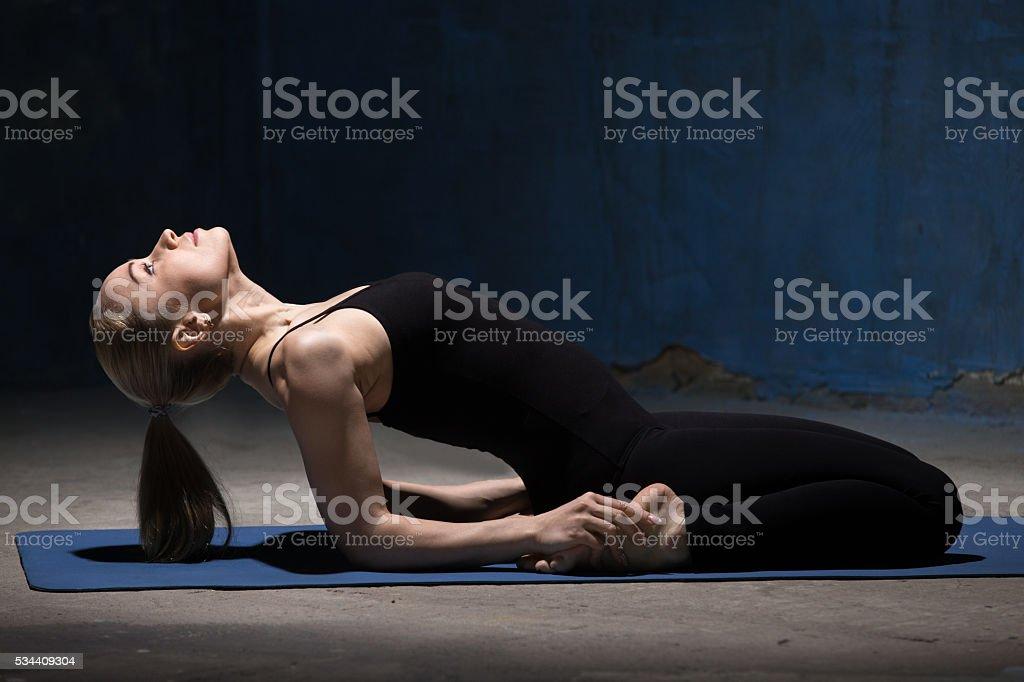 Beautiful Yoga Woman Doing Reclining Hero Pose stock photo