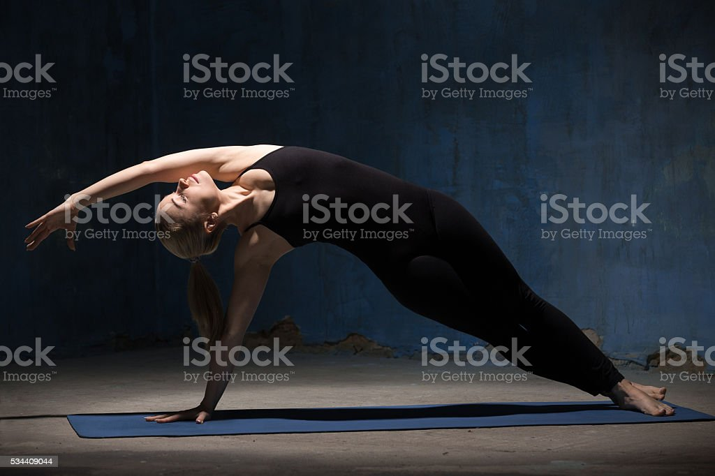 Beautiful Yoga Woman Doing Side Plank Pose stock photo
