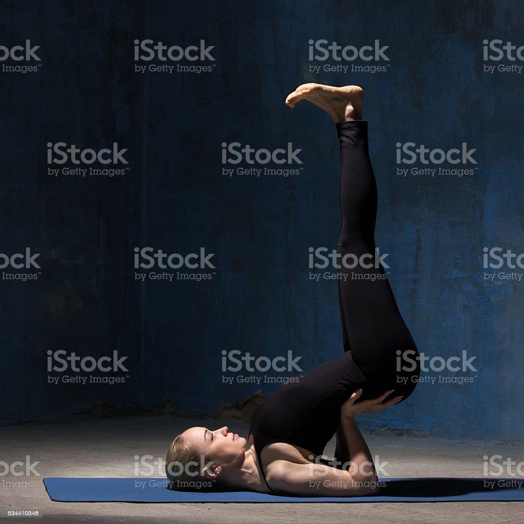 Beautiful Yoga Woman doing Upside-Down Seal yoga Pose stock photo