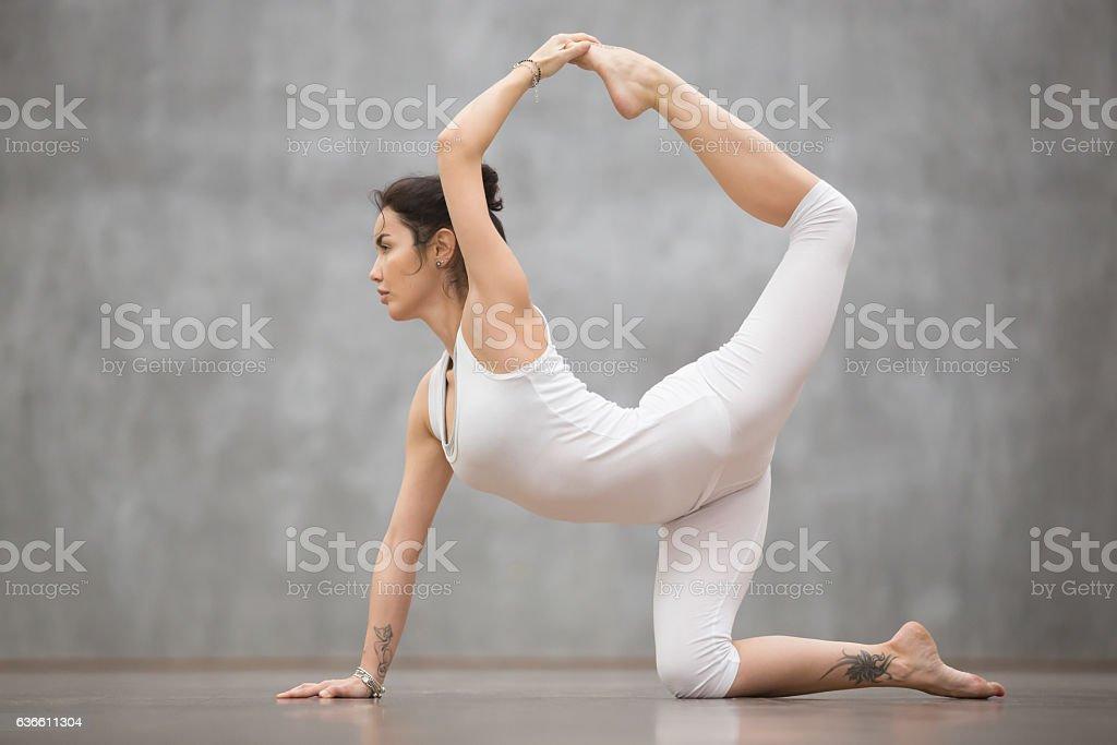 Beautiful Yogi woman doing chakravakasana pose stock photo