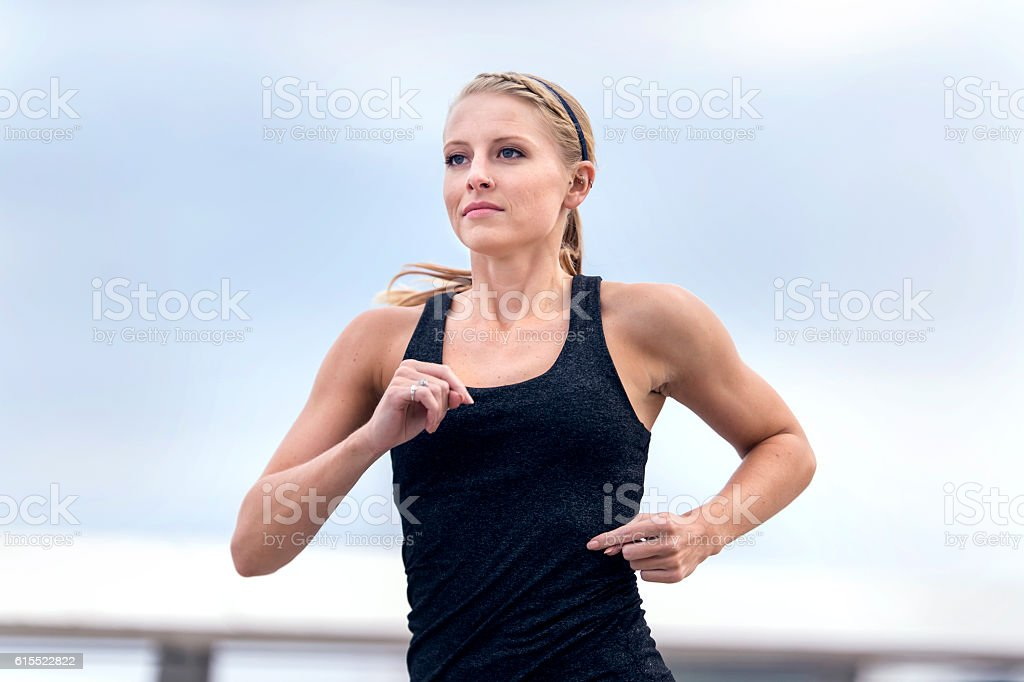 Beautiful young adult female exercising in a tanktop stock photo