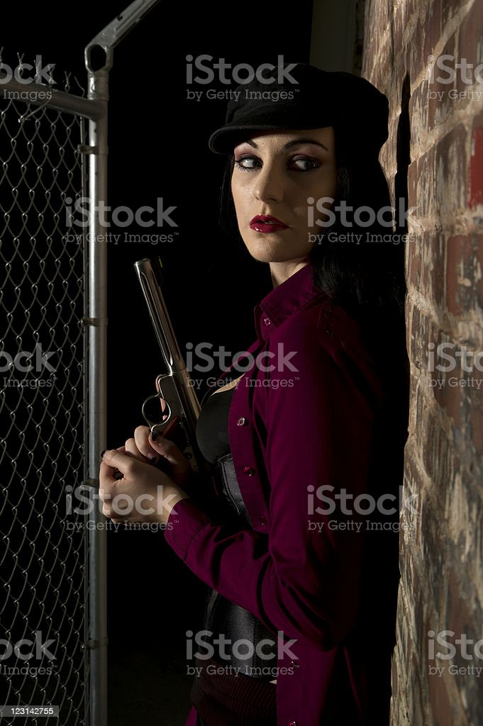 Beautiful Young Adult Female with a Handgun royalty-free stock photo