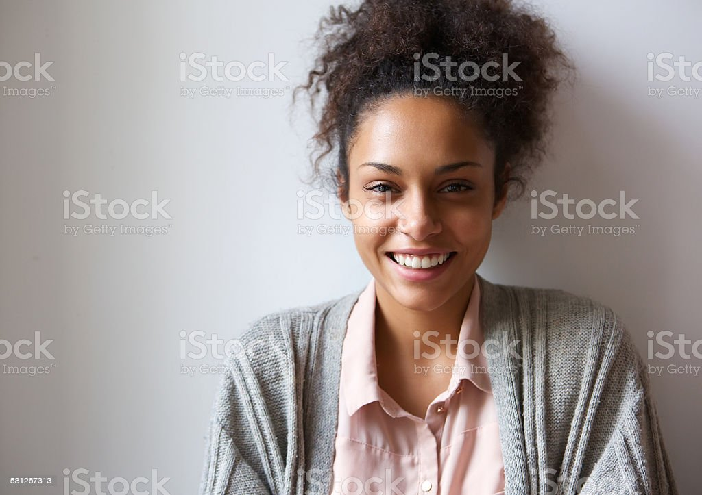 Beautiful young african american woman smiling stock photo