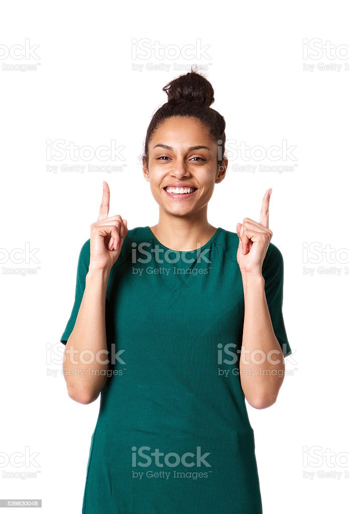 Beautiful young african woman pointing up and smiling stock photo