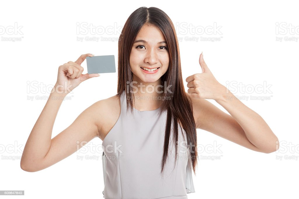 Beautiful young Asian woman hold a blank card stock photo