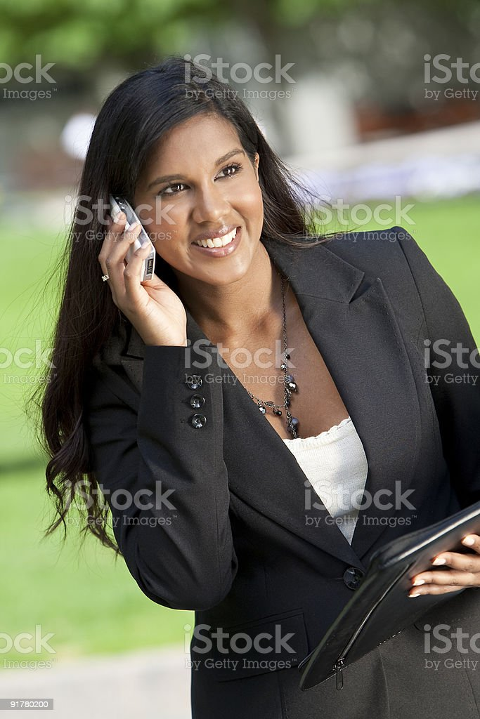 Beautiful Young Asian Woman On Her Cell Phone royalty-free stock photo