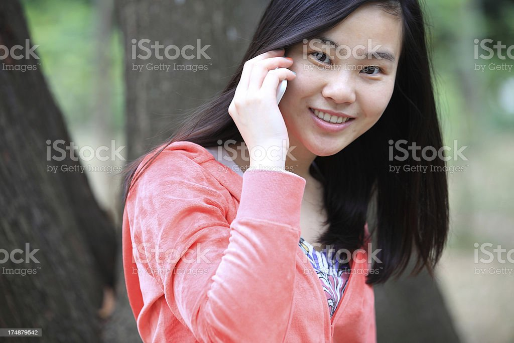 Beautiful young Asian woman smiling call outdoors royalty-free stock photo