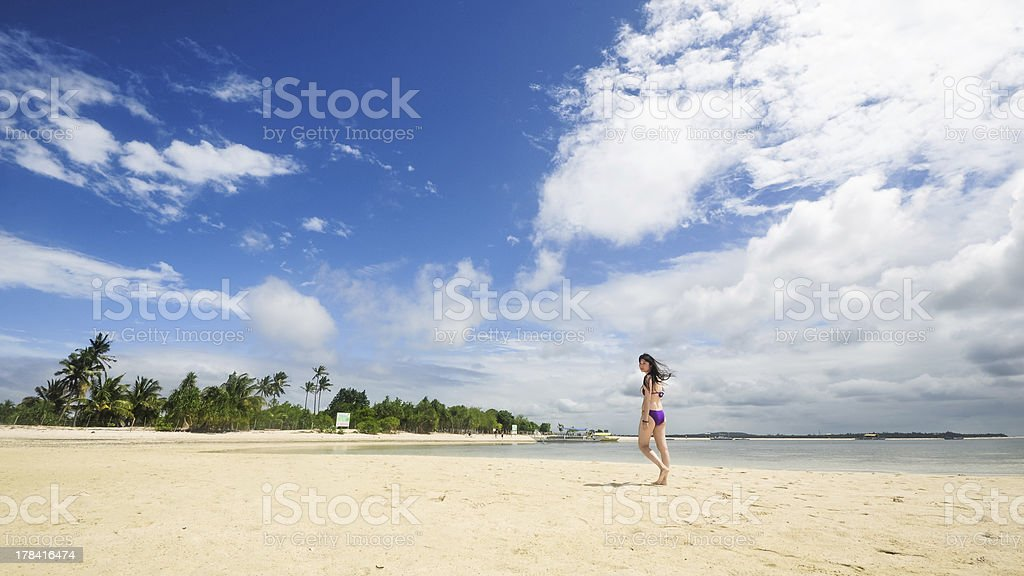 beautiful young bikini girl walks on tropical beach royalty-free stock photo