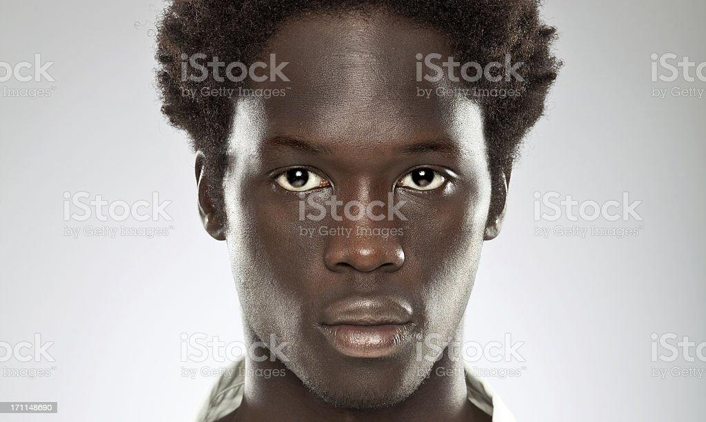 beautiful young black man gaze close portrait stock photo