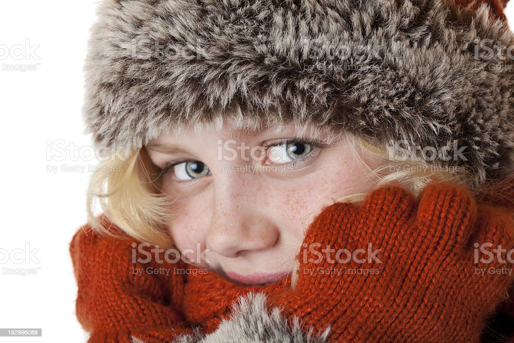 Beautiful young blond girl with winter cap and gloves royalty-free stock photo