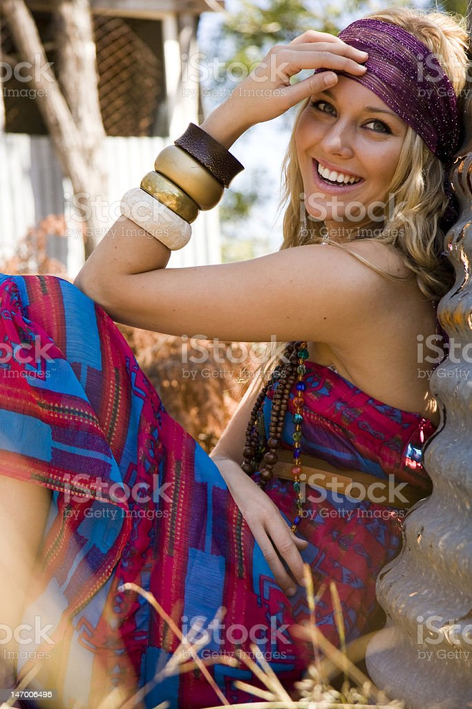 beautiful young blond model sitting in the grass stock photo