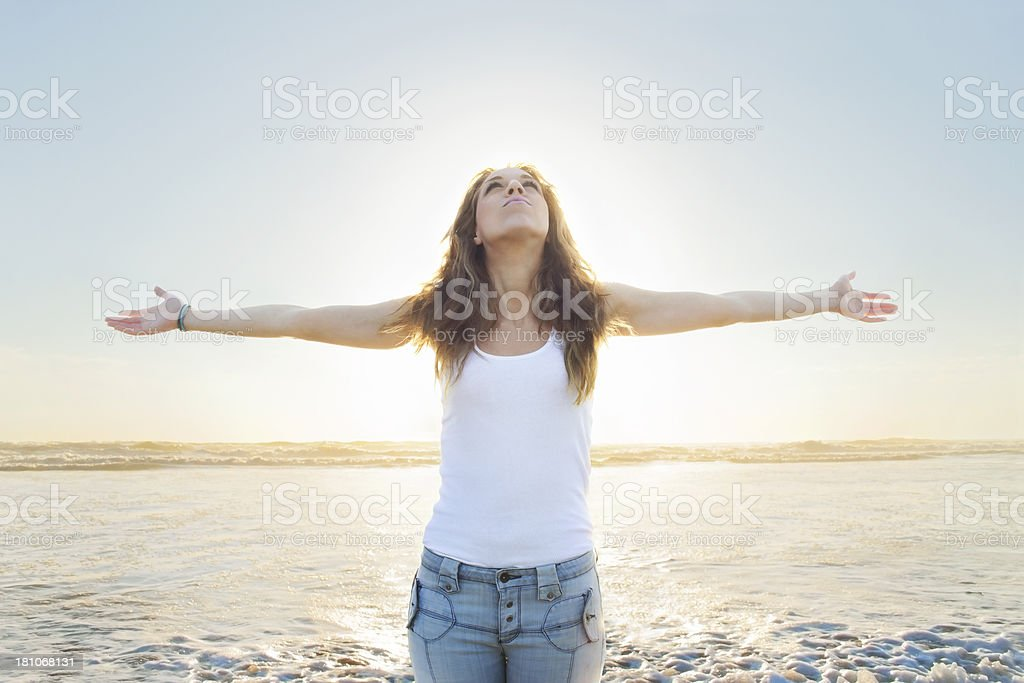 Beautiful Young Blond Woman Being Renewed By the Sea stock photo