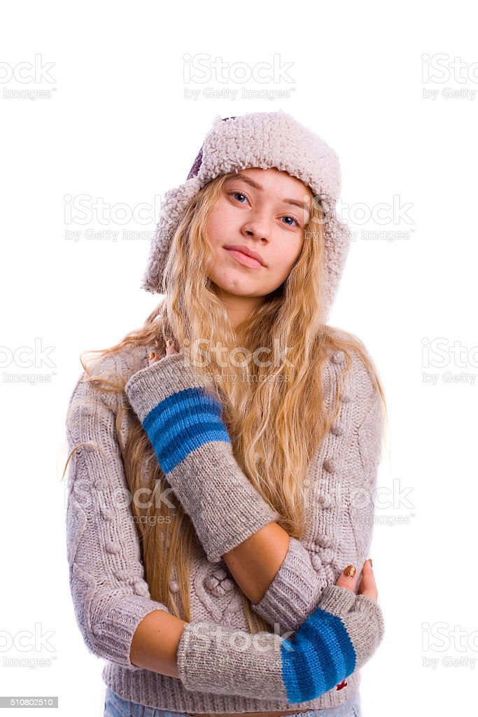beautiful young blond woman in a hat on a white background stock photo