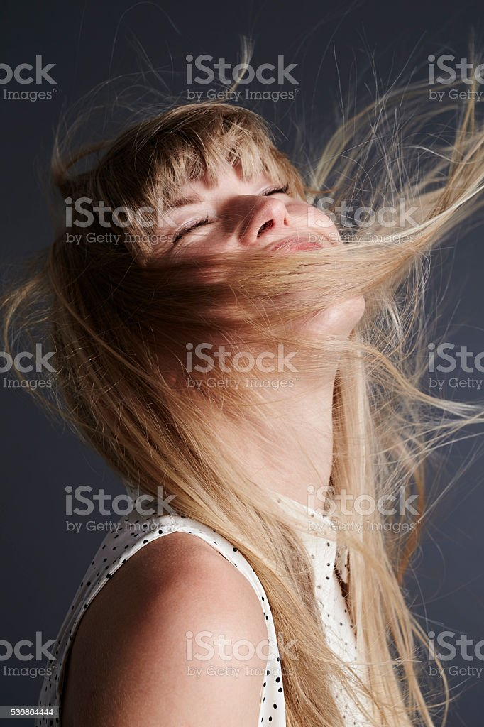 Beautiful young blond woman in ecstasy stock photo