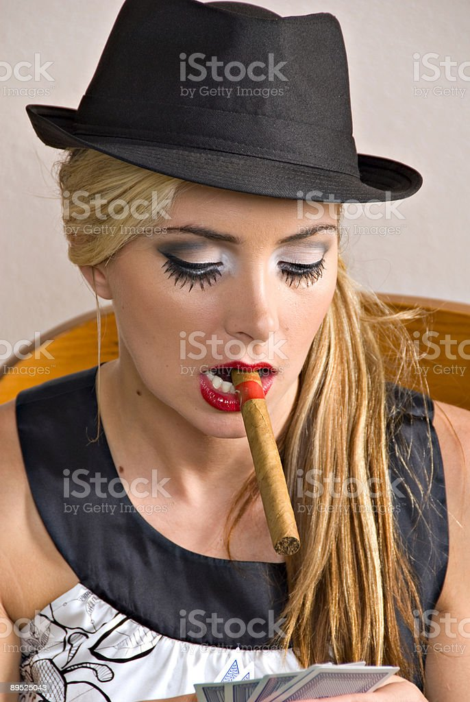 beautiful young blond woman with hat and cigar royalty-free stock photo