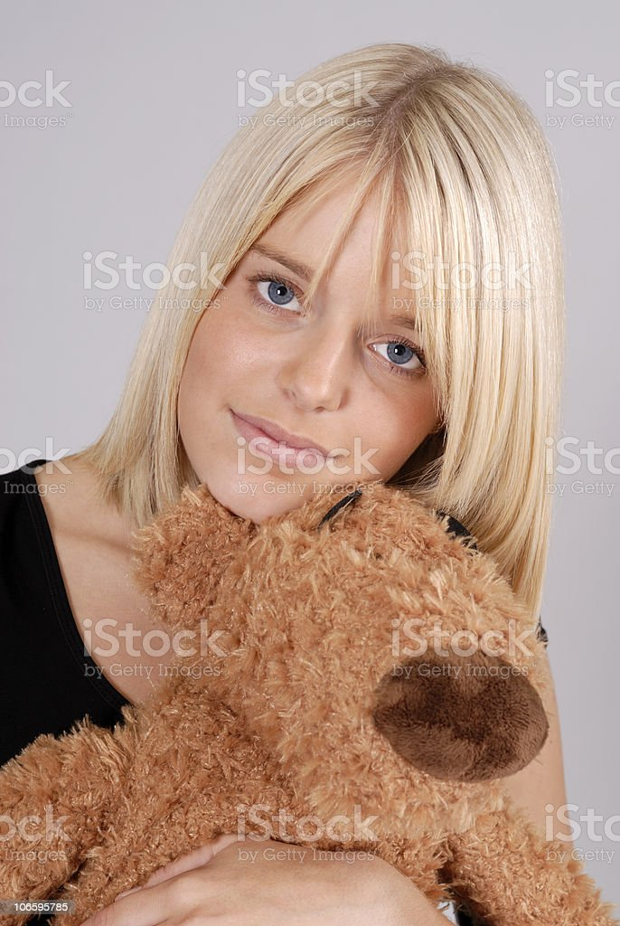 beautiful young blond woman with teddy bear stock photo