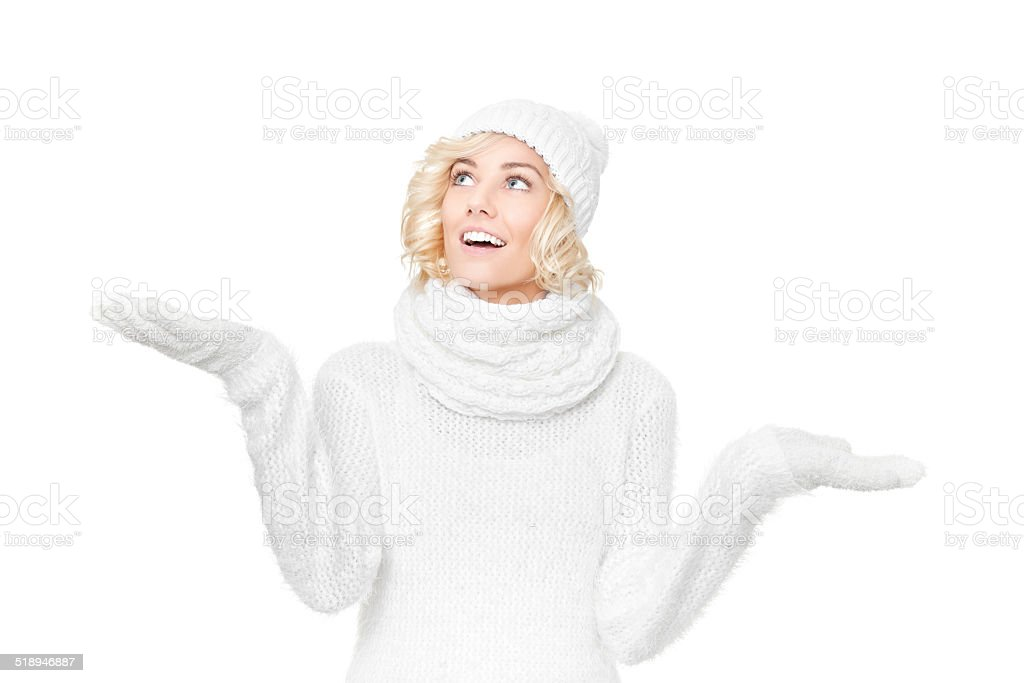 Beautiful young blond woman with winter hat and scarf stock photo