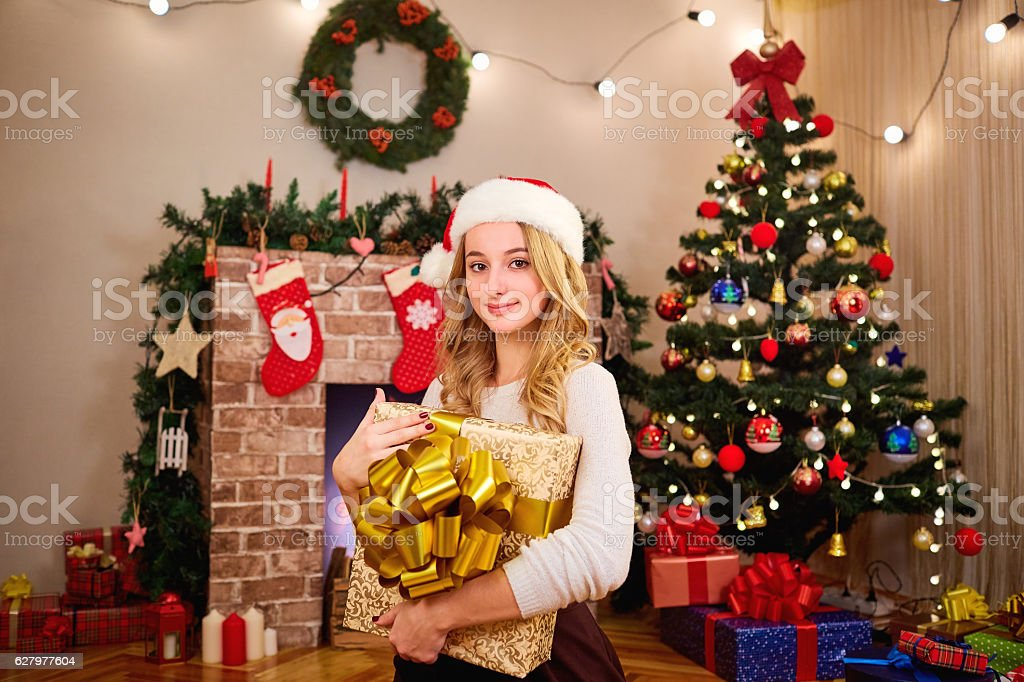 Beautiful young blonde girl in the hat of Santa Claus stock photo