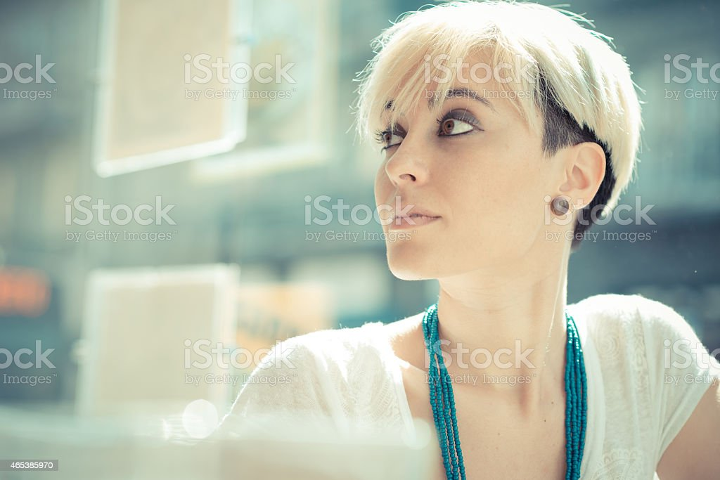 beautiful young blonde short hair hipster woman stock photo