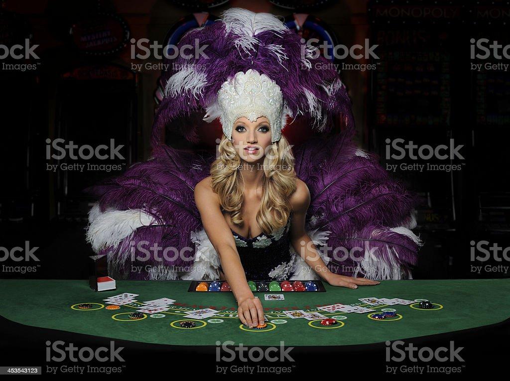 Beautiful young blonde Showgirl dealing Blackjack stock photo