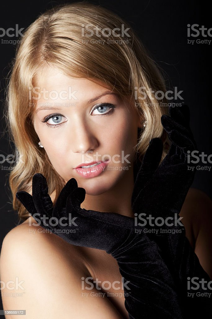 Beautiful Young Blonde Woman in Black Gloves royalty-free stock photo