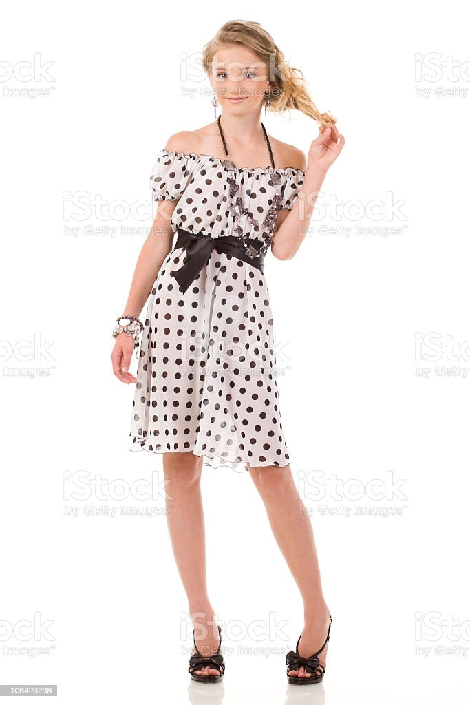 Beautiful Young Blonde Woman in Spotty White Sweater Dress stock photo