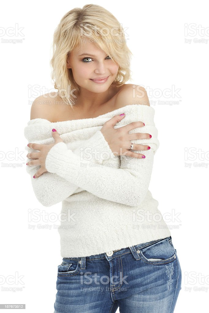 Beautiful Young Blonde Woman in White Sweater and Jeans stock photo