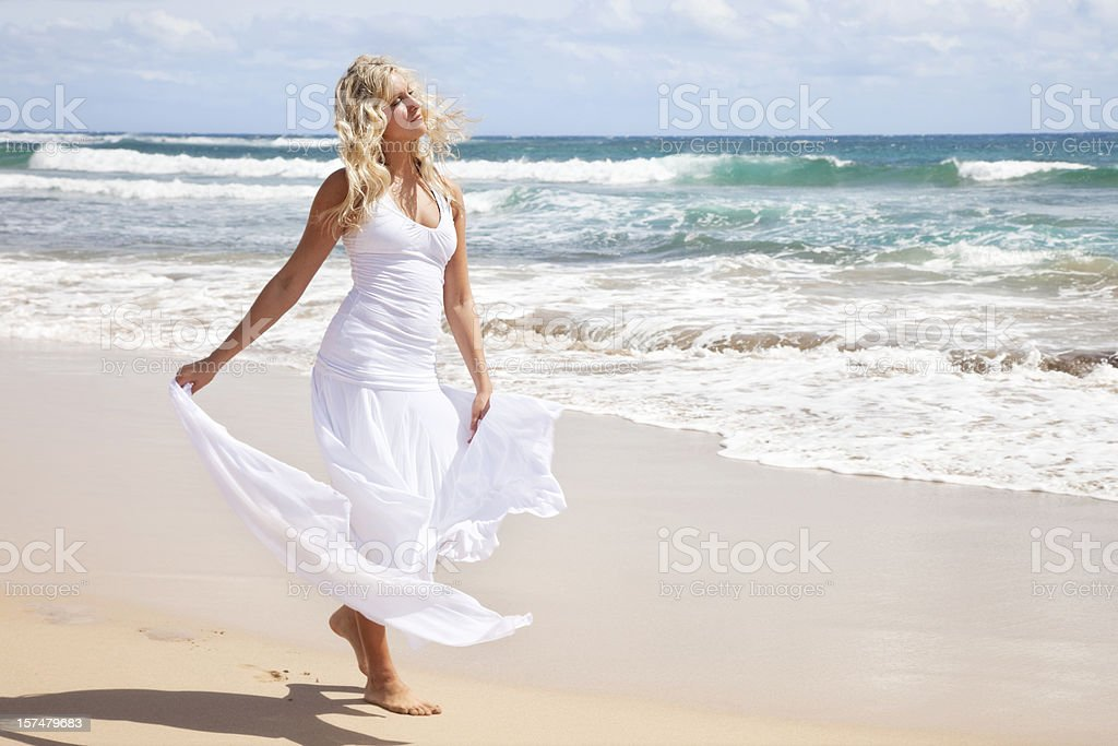 Beautiful Young Blonde Woman on Hawaiian Beach royalty-free stock photo