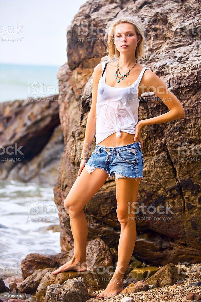 Beautiful young blonde woman posing stock photo