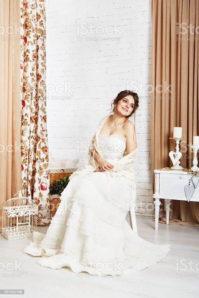 Beautiful young bride in crochet shawl and dress stock photo