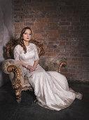 Beautiful young bride in long wedding dress