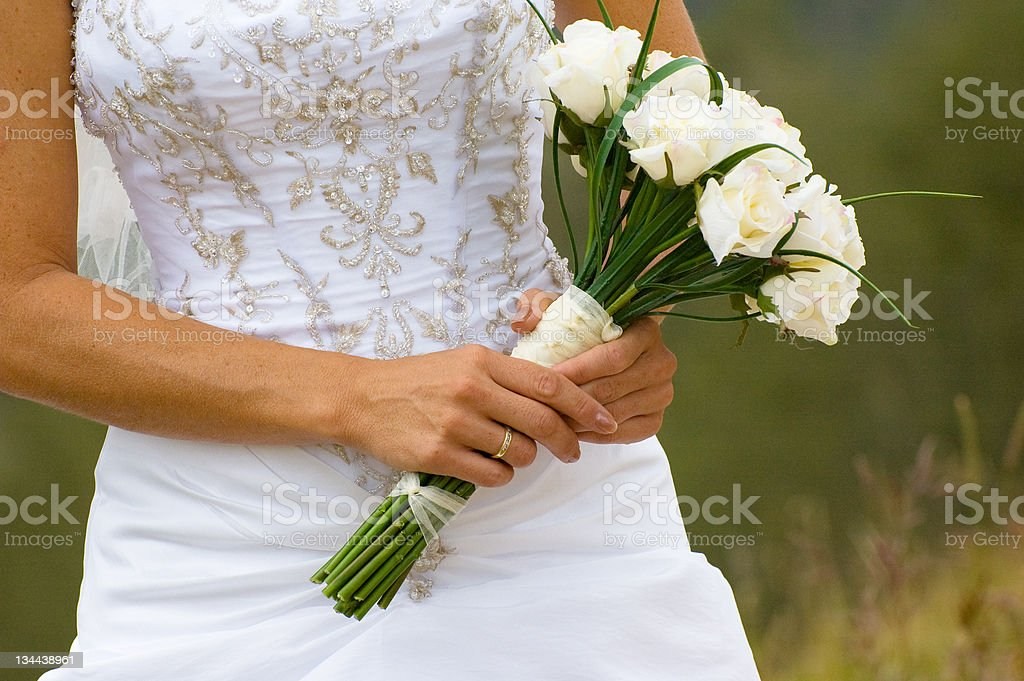 Beautiful Young Bride in Natural Window Light with Flower Bouquet royalty-free stock photo