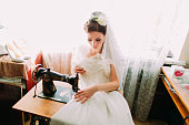 Beautiful young bride makes last minute adjustments to her Wedding