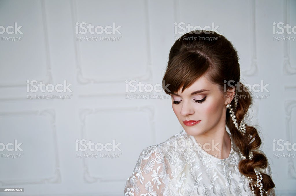 Beautiful young bride with retro hairstyle stock photo