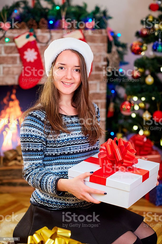 Beautiful young brunette girl in the hat of Santa Claus stock photo