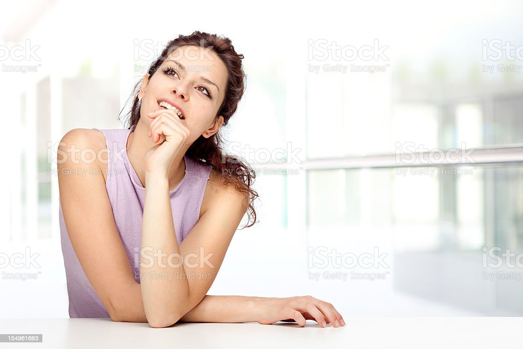 beautiful young brunette girl think expression relax leaning royalty-free stock photo
