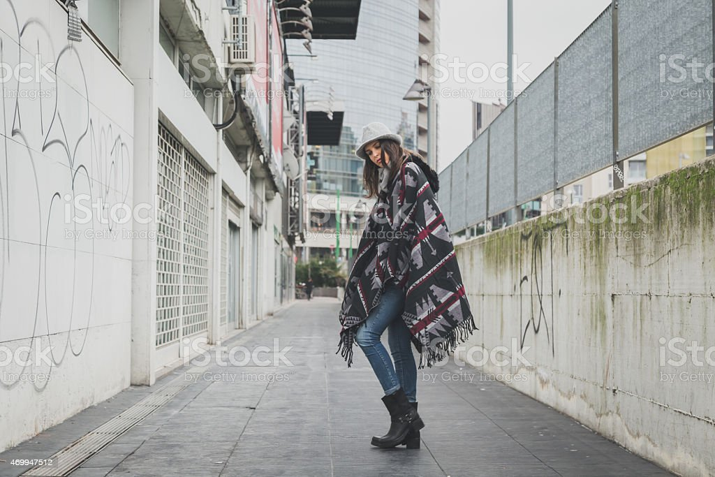 Beautiful young brunette posing in the city streets stock photo