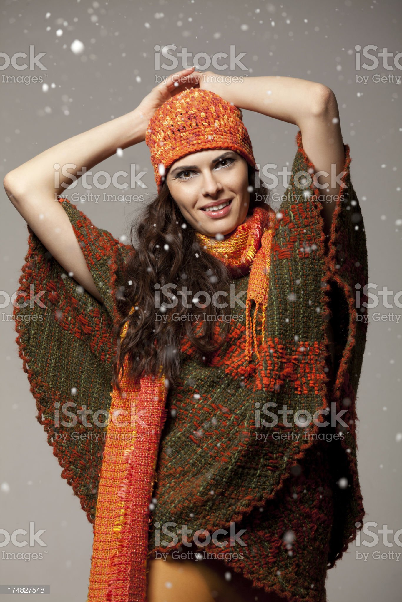 Beautiful young brunette posing in winter clothes royalty-free stock photo