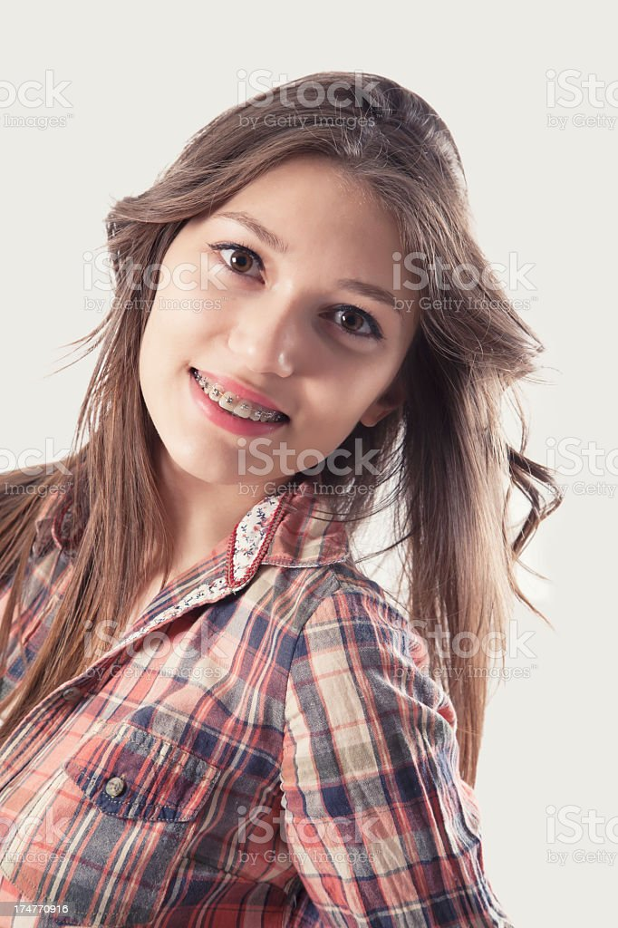 Beautiful young brunette with brackets on teeth royalty-free stock photo