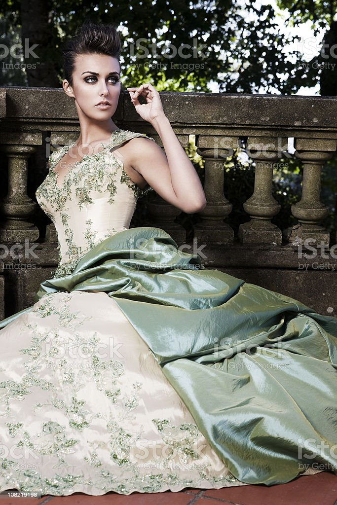 Beautiful Sophisticated Fashion Model in Evening Gown at Castle stock photo