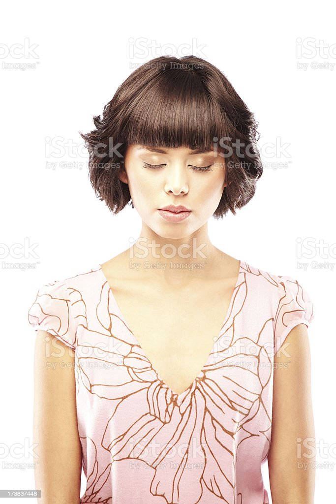 Beautiful Young Brunette Woman Meditating with Eyes Closed royalty-free stock photo