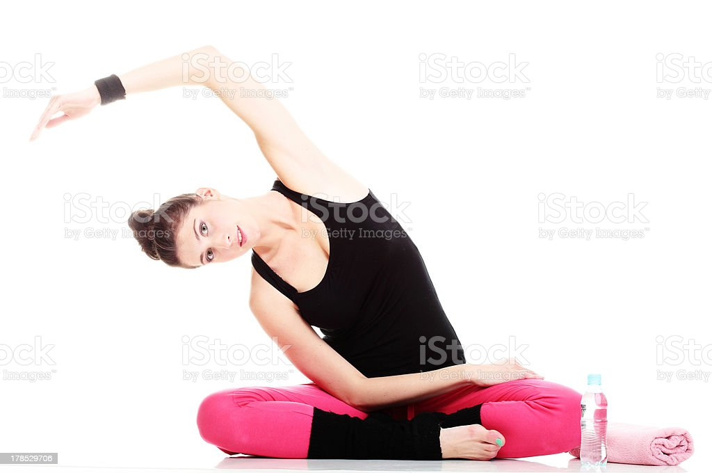 beautiful young brunette woman stretching muscles arms isolated royalty-free stock photo