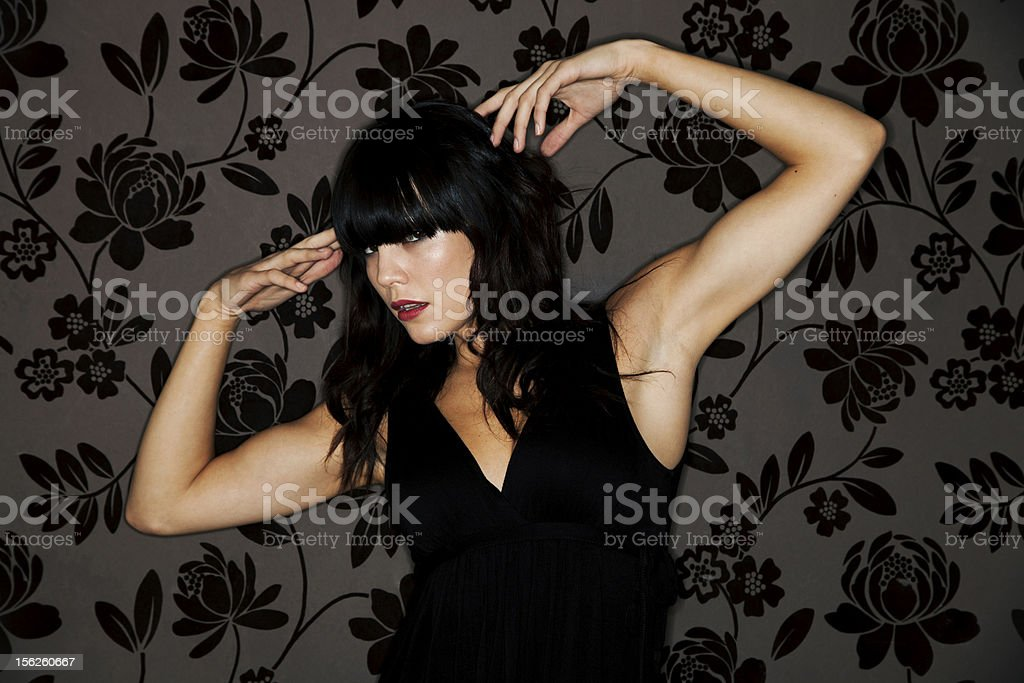 Beautiful young brunette woman wearing a black dress royalty-free stock photo