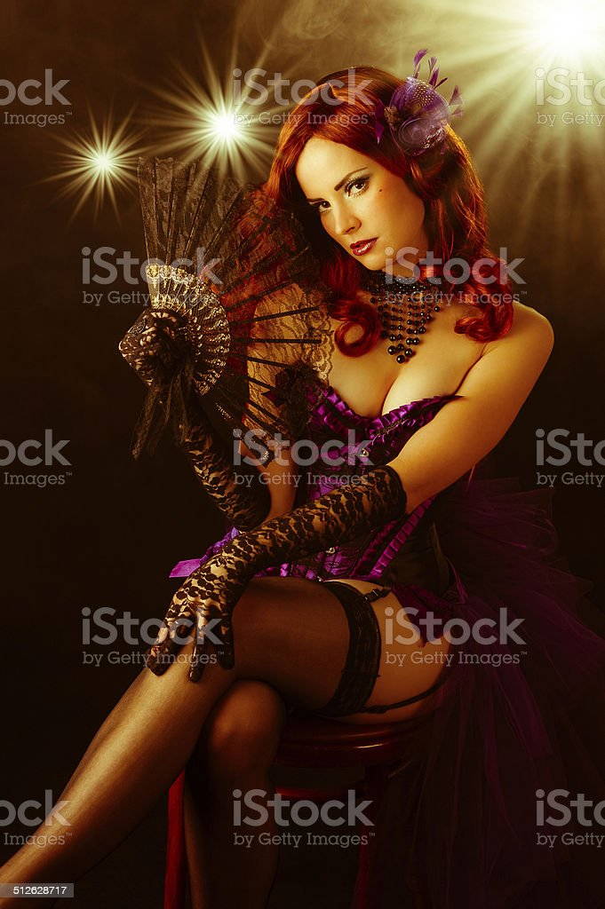 Beautiful young burlesque showgirl on stage stock photo