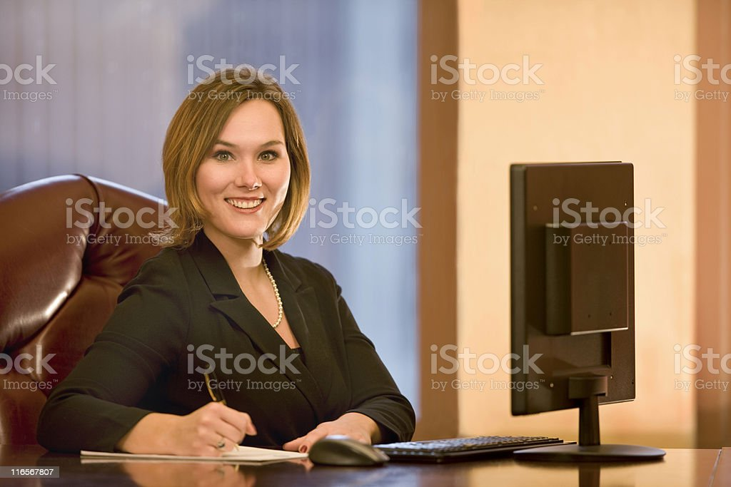 Beautiful Young Business Woman At Work royalty-free stock photo